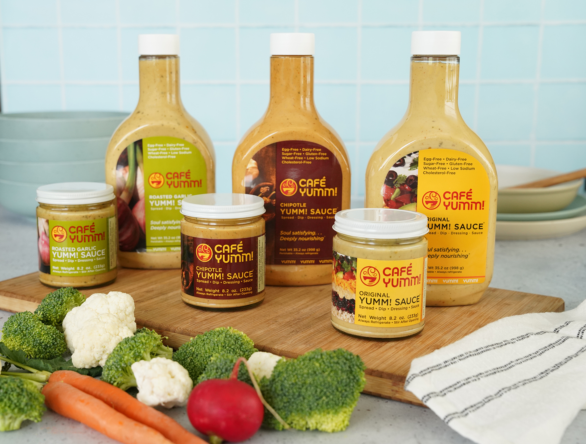 Yumm! Sauce in three flavors with fresh dipping vegetables.